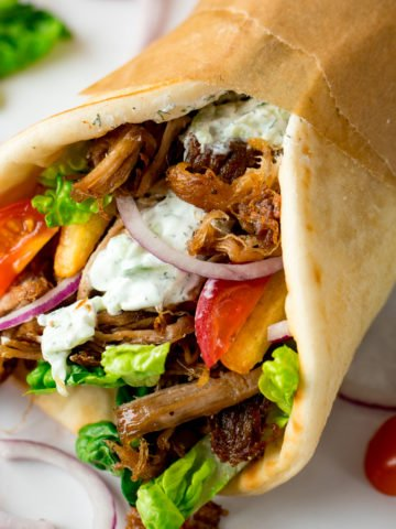 My favourite recipe for Crispy Pork Gyros with Homemade Tzatziki and how to get that perfect crispy-on-the-outside and tender-on-the-inside meat!
