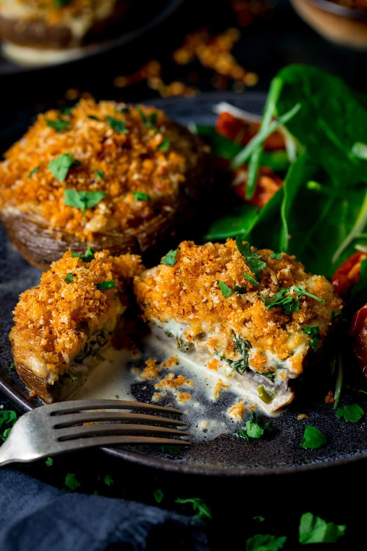 Stuffed mushrooms topped with crispy crumb topping sliced in half