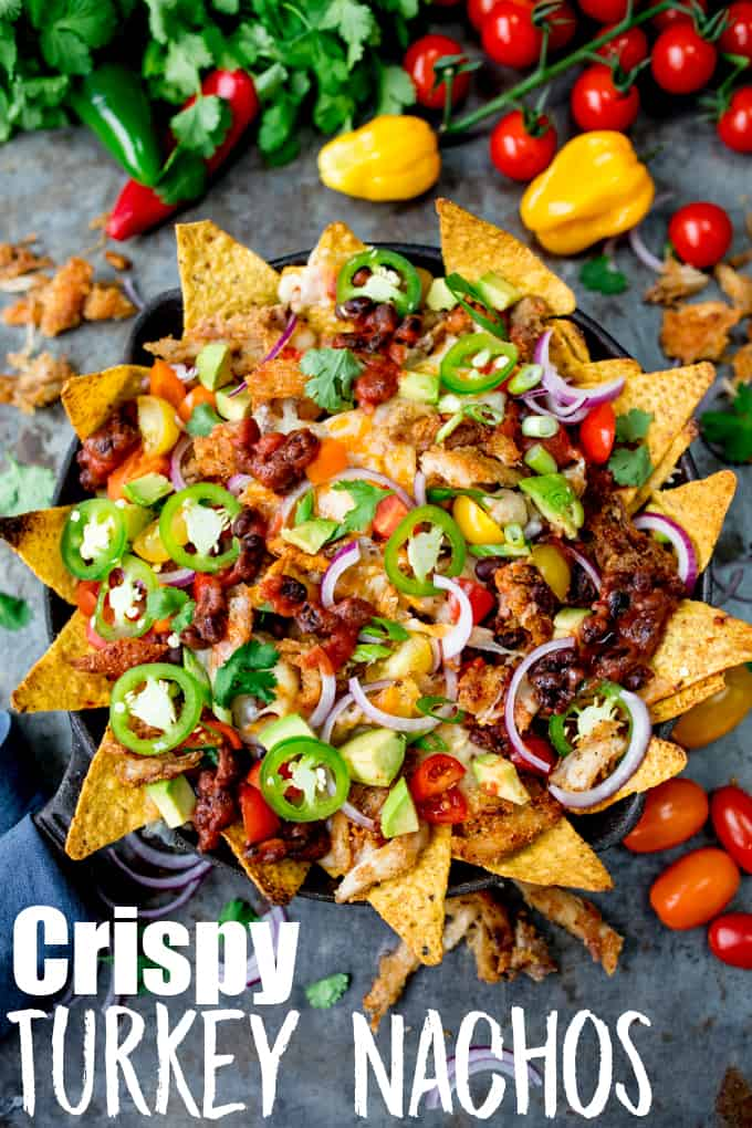 What should you do with all that leftover turkey....Make these Crispy Turkey Nachos!! Crispy fajita-spiced turkey, beans, and a ton of melted cheese!!! #leftoverturkey #turkeynachos #mexicanfood