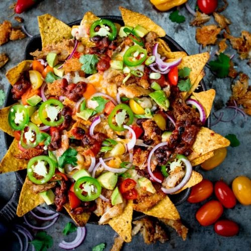 What should you do with all that leftover turkey....Make these Crispy Turkey Nachos!! Crispy fajita-spiced turkey, beans, and a ton of melted cheese!!!