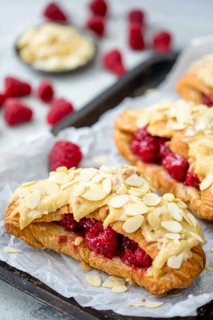 Looking for a breakfast treat? TheseRaspberry and Almond Croissants, filled and topped with frangipane are the best! A great Christmas breakfast!
