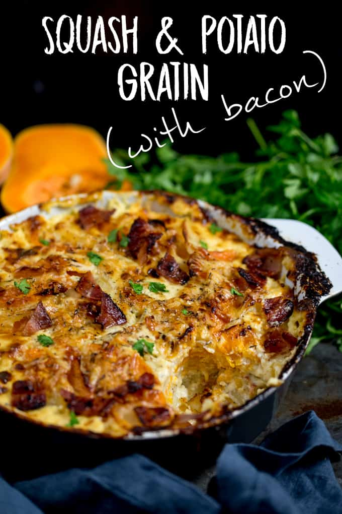 Squash and Potato Gratin in a grey and white backing dish with a scoop taken out, topped with bacon