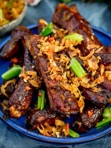 How about these Oven Baked Asian Ribs with Crispy Onions for Chinese New Year? Slow cooked in the oven until tender, then brushed with a sticky marinade and finished with crispy onions!