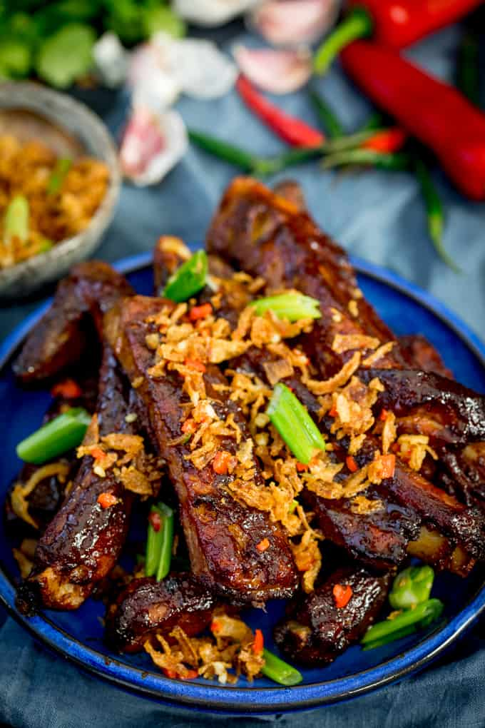 Oven Baked Asian Ribs with Crispy Onions on a blue plate