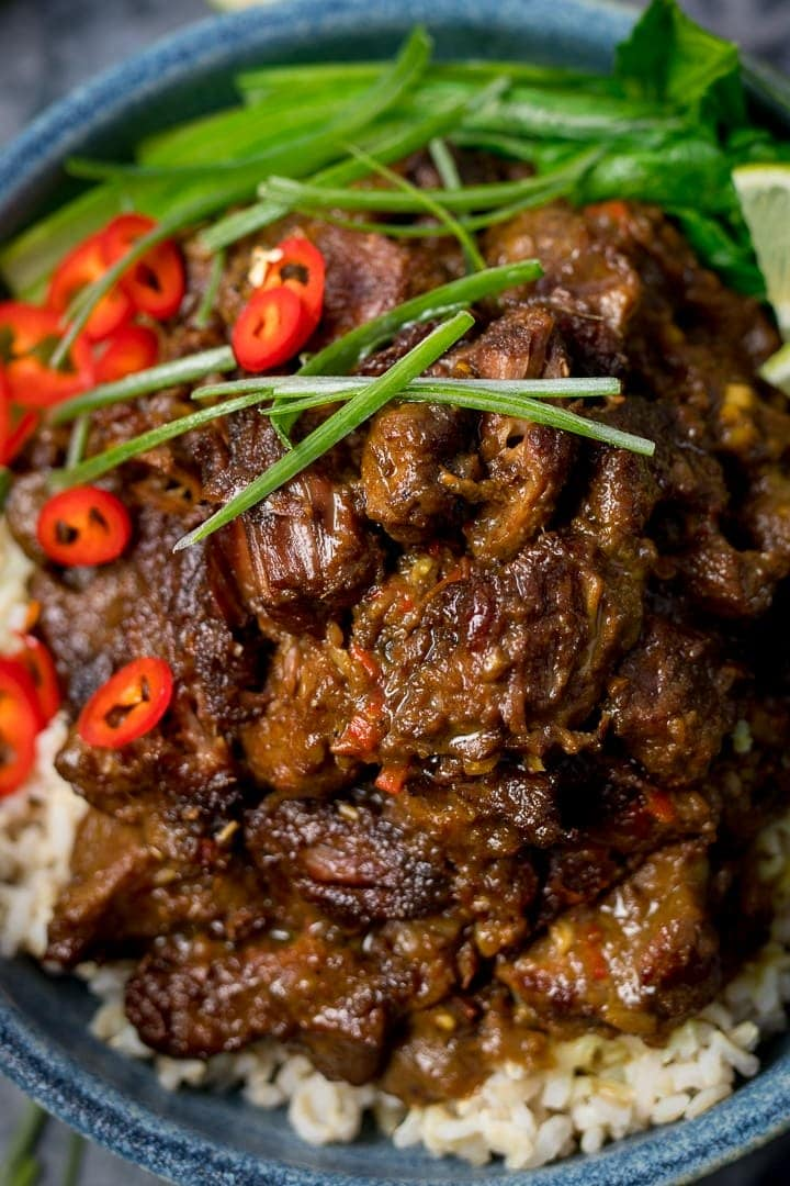 Close up of Beef rendang on a bowl of rice