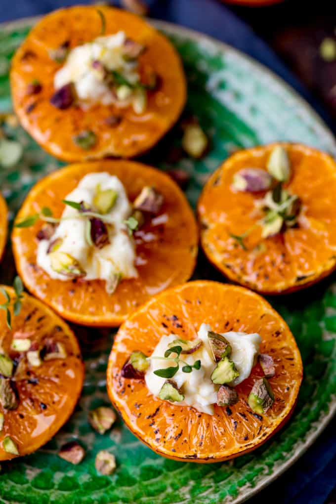 Brown Sugar Glazed Clementines with Cream Cheese, Honey and Pistachios on a green plate