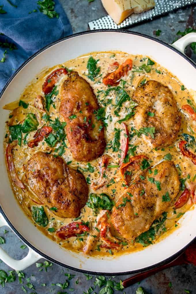 4 chicken breasts in pan with sundried creamy tomato sauce, spinach and peppers.