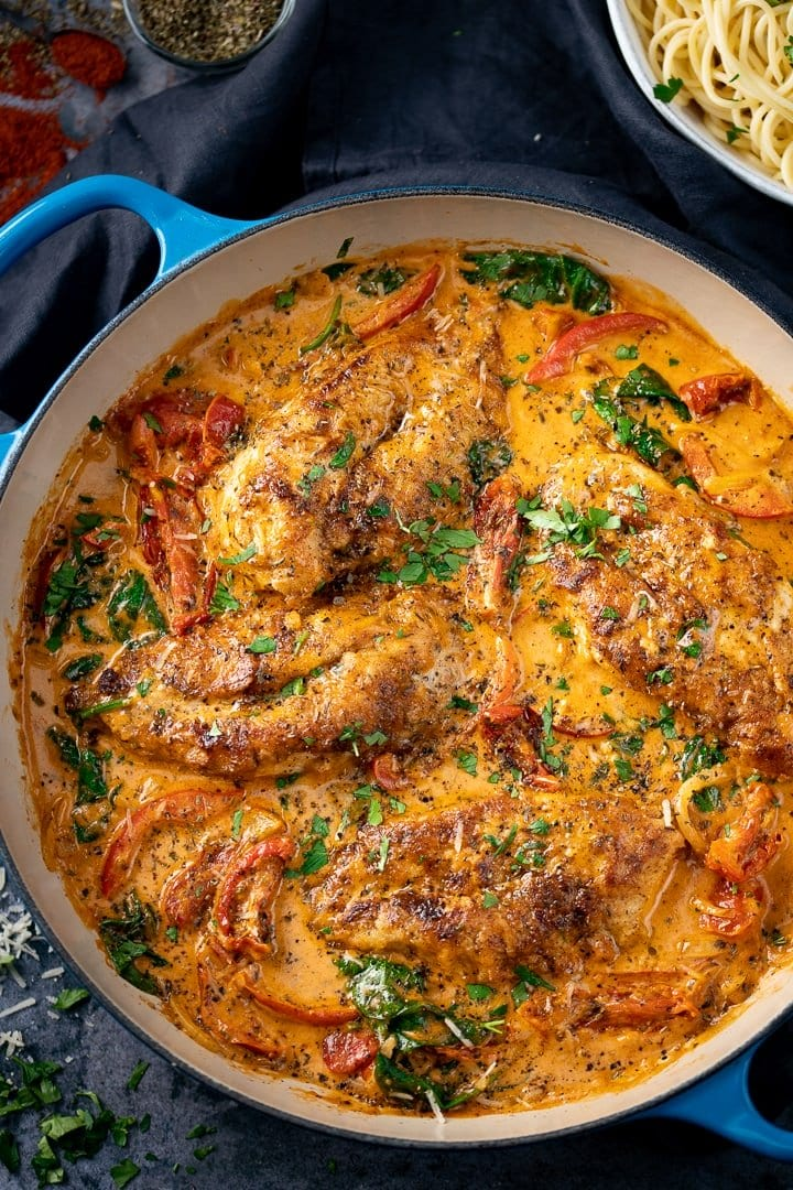 Creamy Tuscan Chicken in a blue pan
