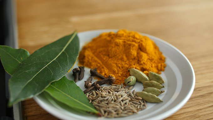 Indian spices on a small white plate
