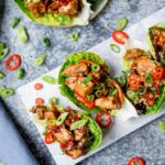 Square image of Asian chicken lettuce wraps in a marble serving board