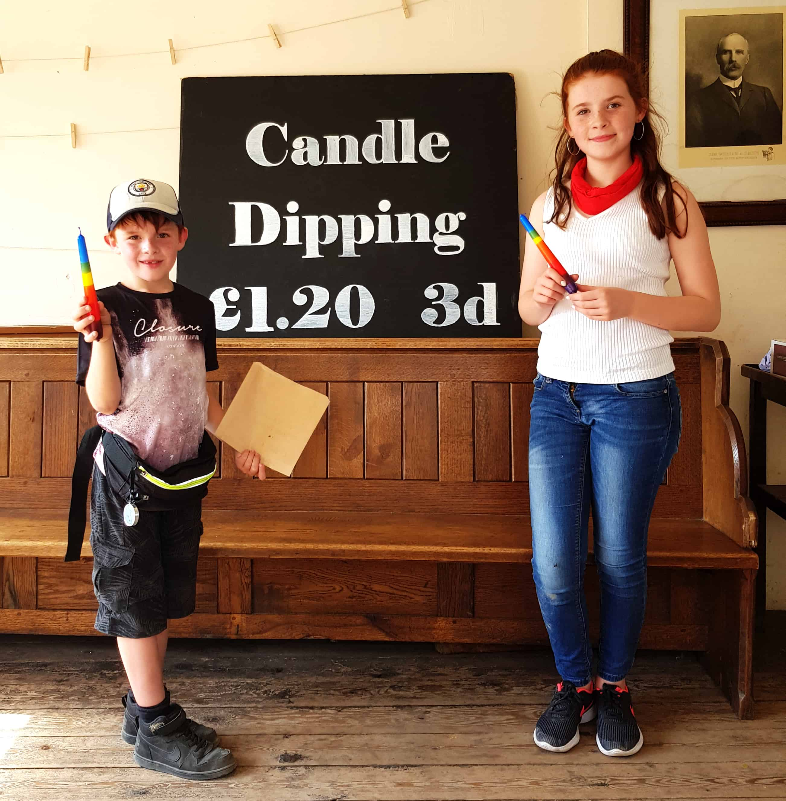 Kids showing their candles after candle dipping