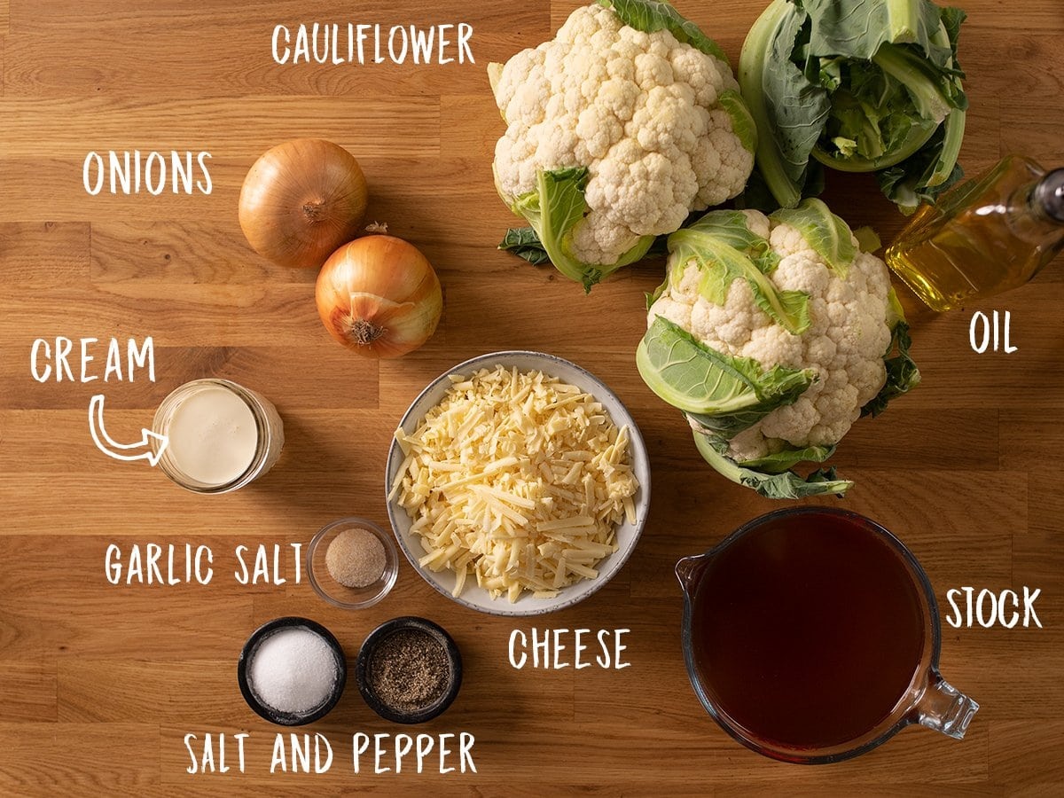 Ingredients for cauliflower soup on a wooden table
