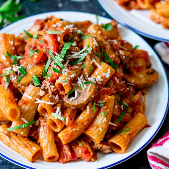 Square image of a plate of mushroom ragu with rigatoni