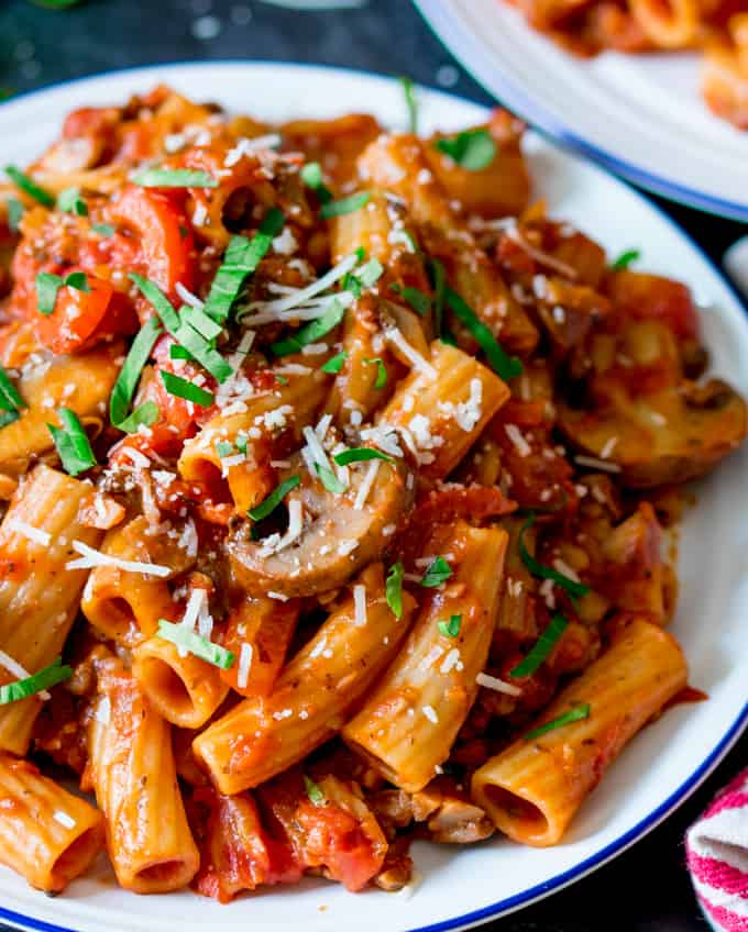 Close up image of a plate of rigatoni with mushroom ragu