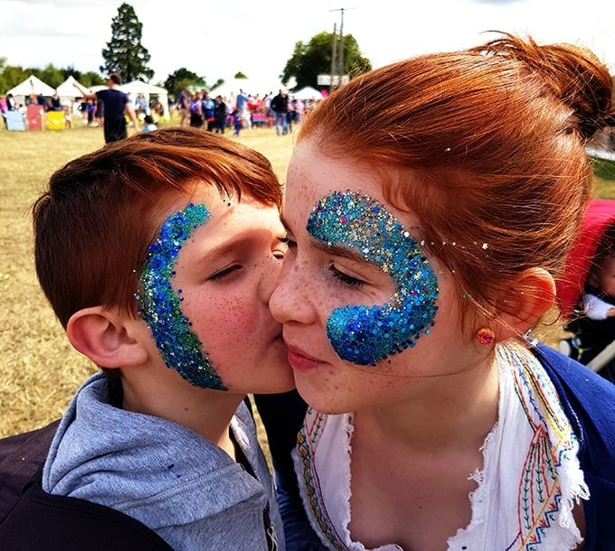 The kids with blue sparkle glitter on their faces at the Big Feastival