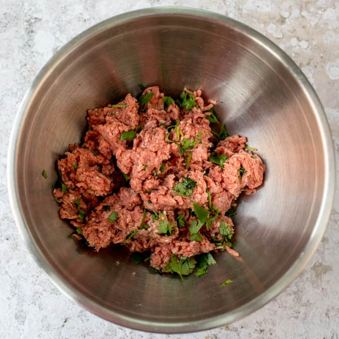 Beef mince and coriander in a bowl