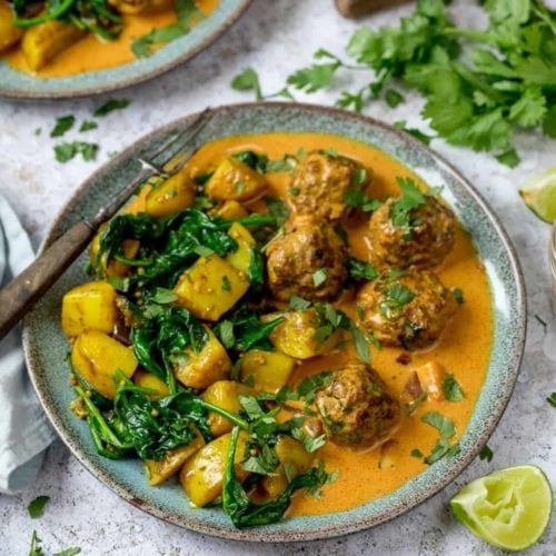 Square image of beef kofta with saag aloo