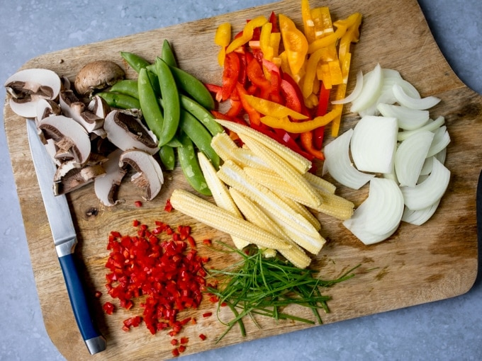 Chopped vegetables on a board for a stir fry
