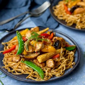 Plate of honey and soy chicken stir fry with noodles