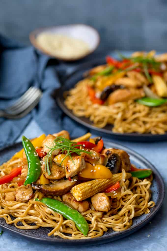 Close up of Plate of honey and soy chicken stir fry with noodles