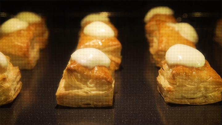 Mozzarella melting on puff pastry squares