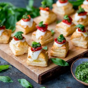 Puff pastry caprese bites on a serving board