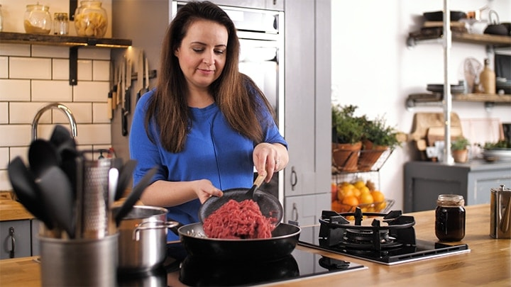 Adding minced beef to pan for cottage pie