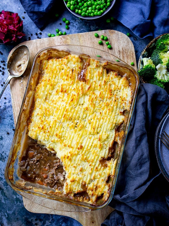 Dish of cottage pie with scoop taken out