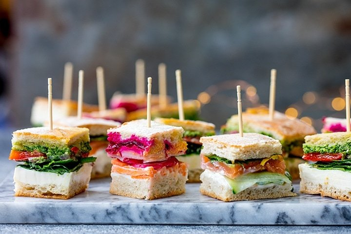 Wide image of mini sandwich bites with different fillings