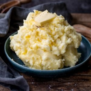 Pile of mashed potatoes with butter on top