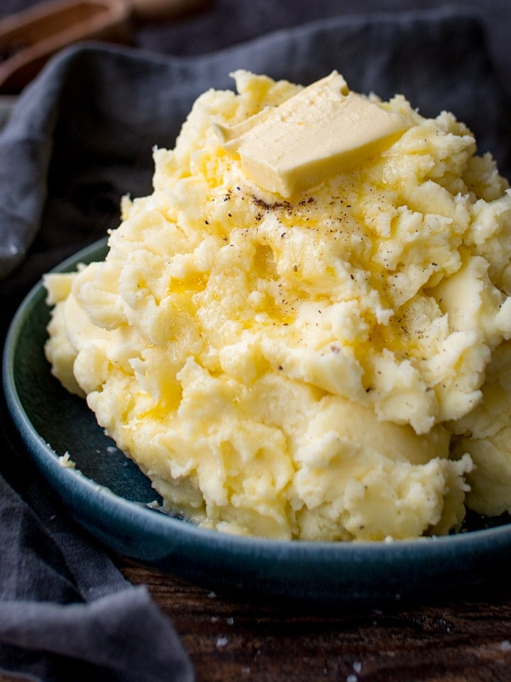 Close up of mashed potatoes with melting butter on top