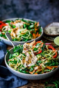 2 bowls of chicken zoodle salad with Thai peanut sauce