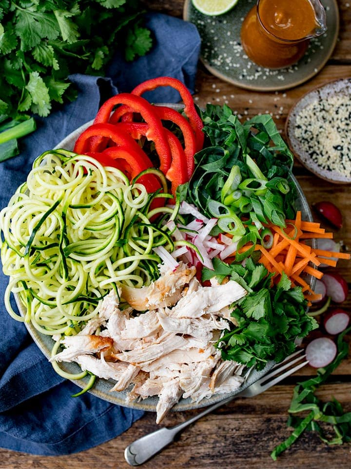 Ingredients for chicken zoodle salad in a bowl