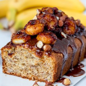 Banana bread with caramelized bananas one a white background