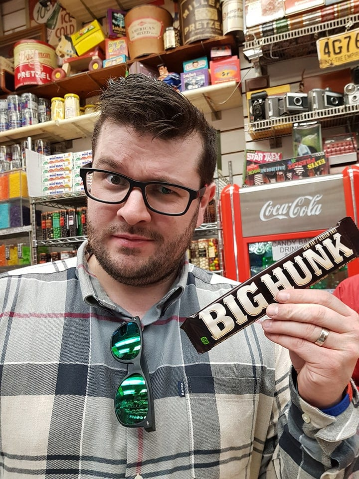 Chris posing with a big hunk candy bar