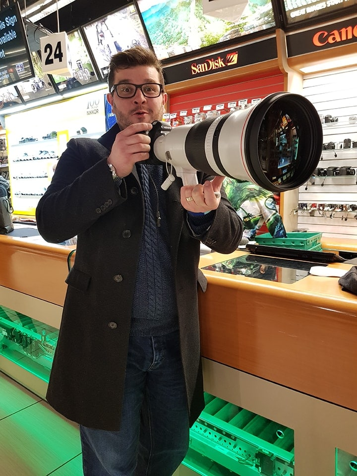 Chris trying out a huge lens in B and H in New York