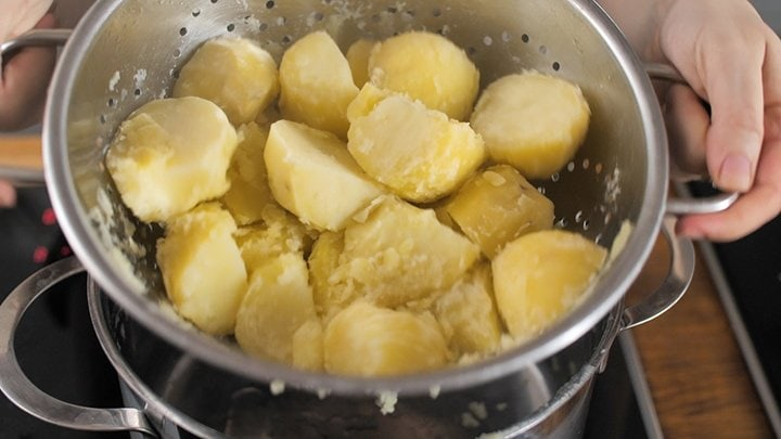 Boiled Potatoes being shaken in a colander