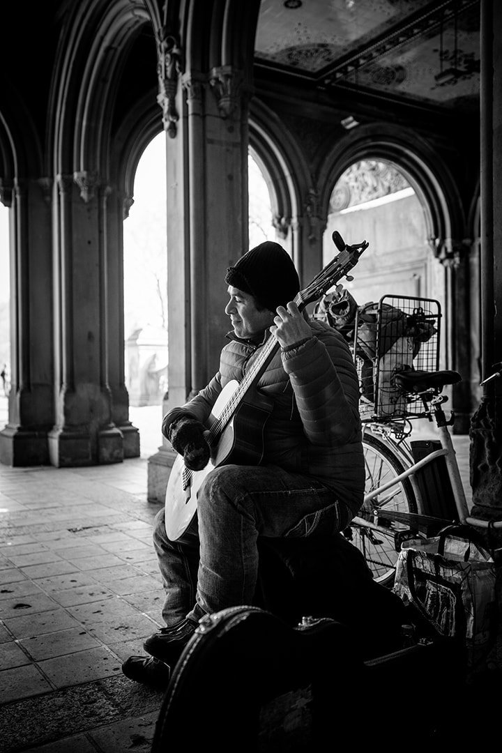 Black and white image of a central park busker