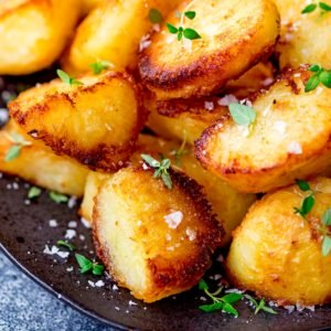 Roast potatoes with salt and fresh thyme leaves