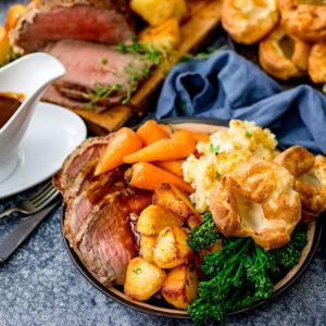 Roast beef dinner with jug of gravy