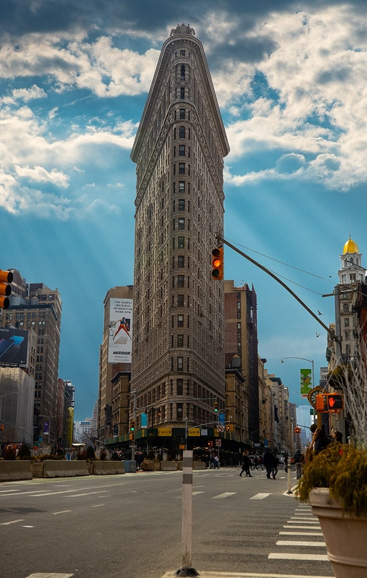 Flat iron building in New York against a blue sky
