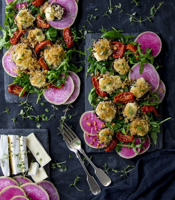 Overhead image of brie stuffed mushroom salad with watermelon radish slices and sun dried tomatoes