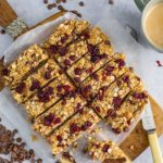 Overhead image of peanut butter, chocolate and cranberry granola bars chopped into slices