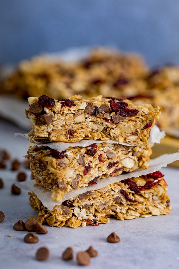 3 stacked Peanut Butter Granola Bars with more granola bars in the background