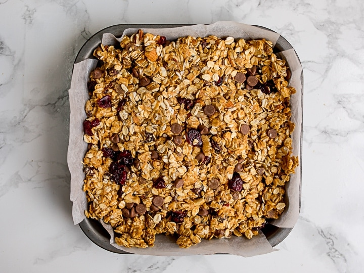 Granola bar mixture in a baking tin