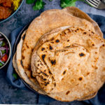 Stack of Chapati on a plate on blue background