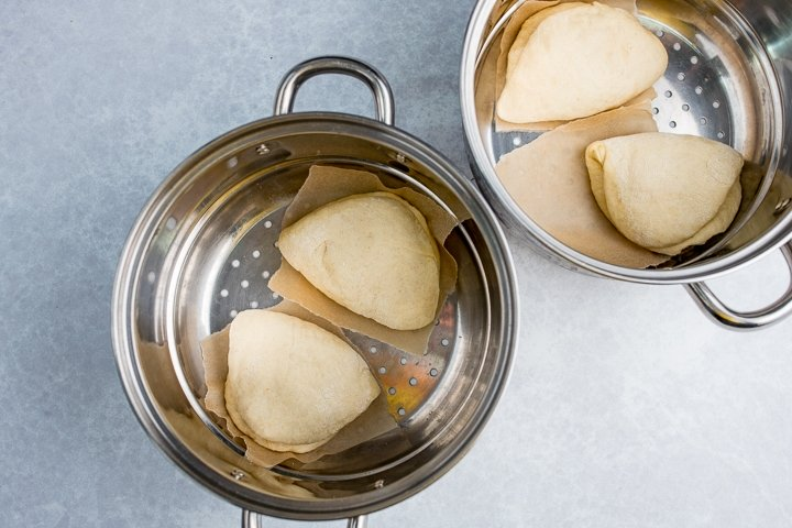 Bao buns in a steam pan ready to be steamed