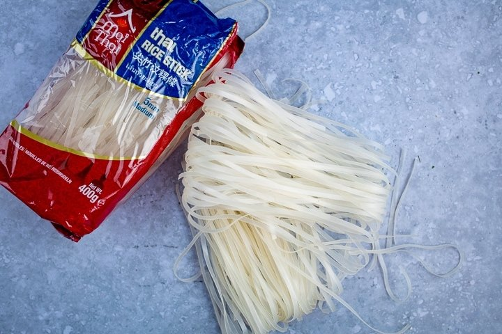 Dry flat rice noodles on a blue background