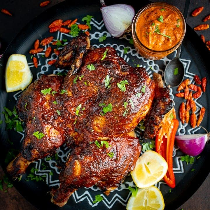 Roasted peri peri chicken on a tray