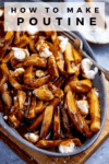 Poutine in a grey dish on a wooden board with text overlay
